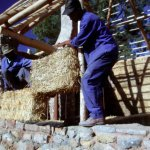 Straw bales being positioned as infill