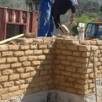 Building of the adobe brick wall 1
