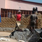 Building of the adobe brick wall 2