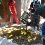 Lime dung plaster mixing 3